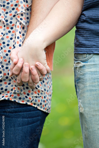 Caucasian Couple Holding Hands
