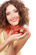 Lovely woman with handful of strawberry