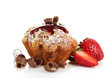 Tasty muffin cake with strawberries and chocolate, isolated