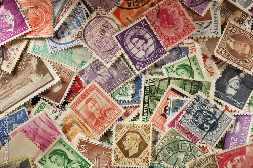 Leinwanddruck Bild Colorful Vintage Used Postage Stamps