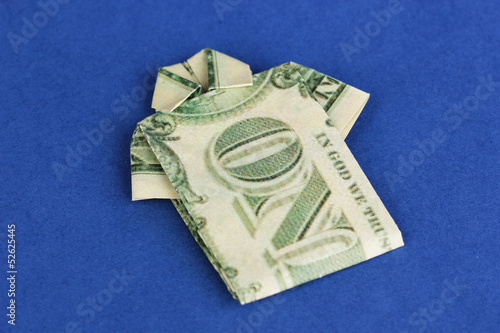 Dollar folded into shirt on blue background