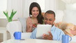 Happy couple using tablet pc on couch