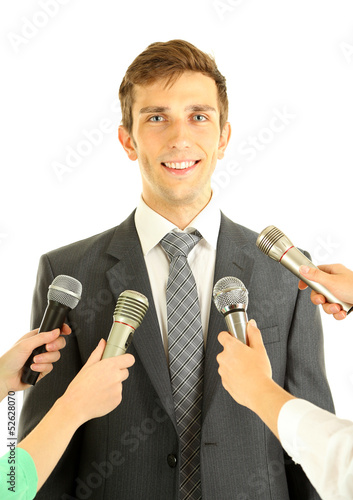 Interview with a young businessman, isolated on white