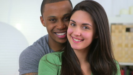 African American and Caucasian Couple smiling together