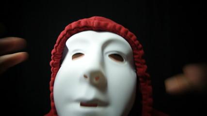 Crazy horror masked man over dark background