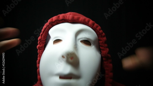 Crazy horror masked man over dark background