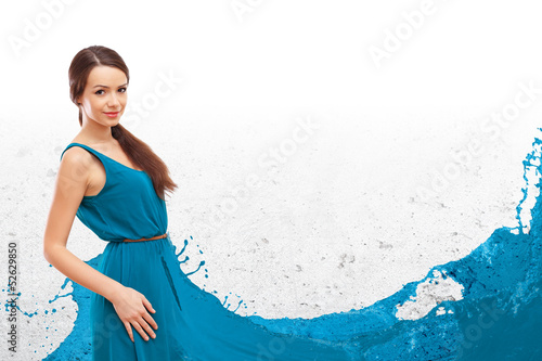 Woman in dress in wave like manner