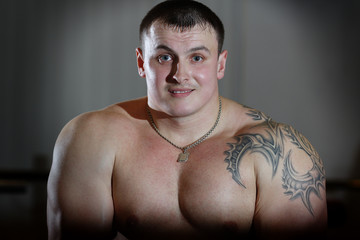 Portrait of powerlifter with tattoo