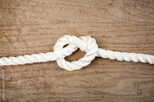 Nylon rope knot on a wooden background