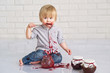 Cute little boy got messy eating strawberry