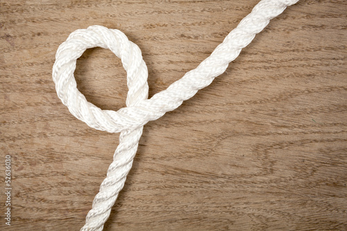 Nylon rope loop on a wooden background