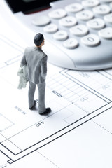 male banker evaluating cost of construction