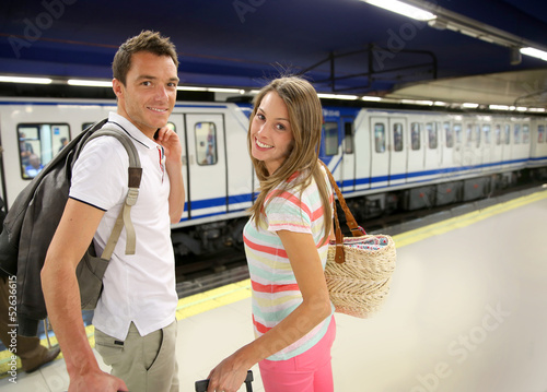 Couple of tourists waiting to get in train