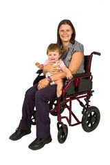 A smiling girl with a baby  in a wheelchair isolated on white ba
