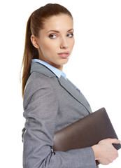 young attractive business woman uses a mobile tablet computer wi