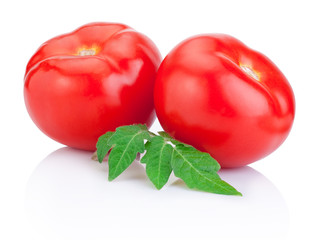Two Juicy Red tomato with leaves Isolated on white background
