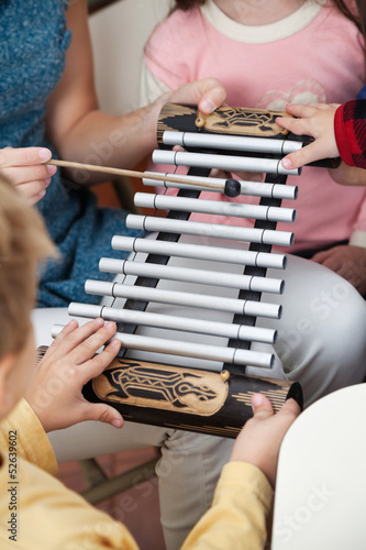 Teacher And Students Playing Xylophone In Class