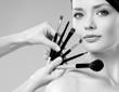 beautiful woman. Makeup brushes.