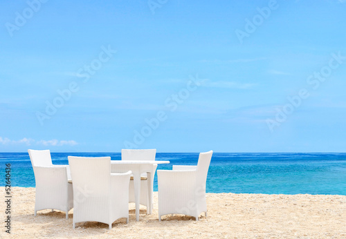 Luxury white chairs and table on white sandy beach
