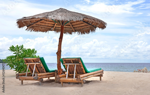 Relaxing couch chairs on white sandy Beach