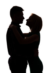 Young couple hug silhouette on white background