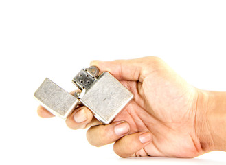 classic silver gasoline lighter in man hand