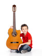 happy  boy is playing on acoustic guitar