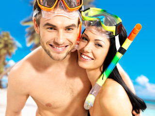 fun beautiful couple  at tropical beach with swimming mask