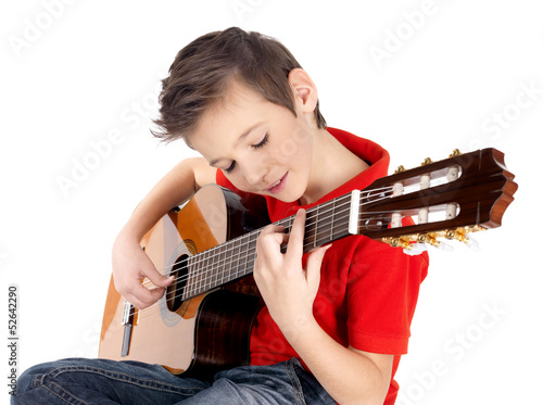 White boy is playing on acoustic guitar