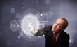Businessman touching abstract high technology circular buttons