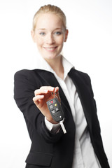 Young woman giving car key