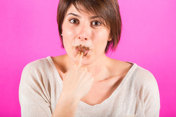 Young Woman Eating Chocolate Cream