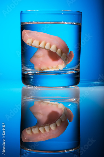 dentures in a water glass