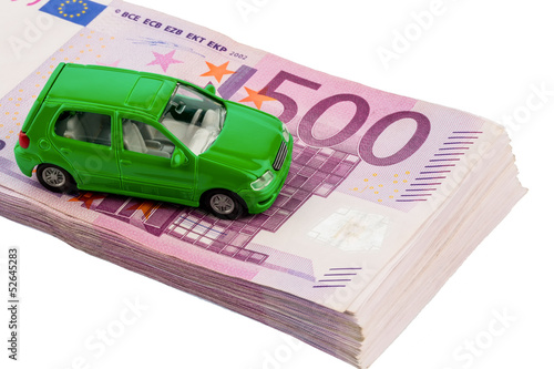 green car on banknotes