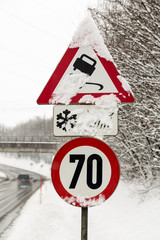 traffic signs and snow