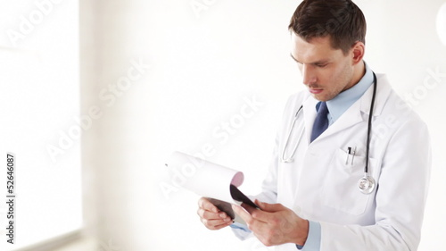 male doctor making a prescription