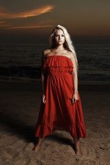 beautiful blond woman on a beach. sunset