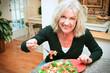 Sexy Senior Woman Eats Healthy