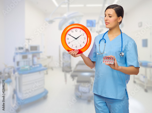 Doctor with pills and clock