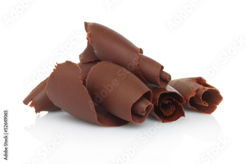 Chocolate shavings on white background.