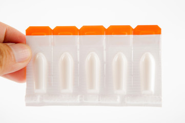 Suppository tablet on white background