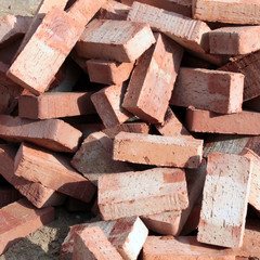Heap of red ceramic bricks