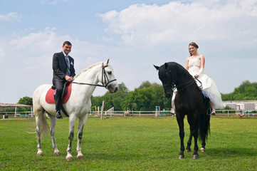 Wedding bride and groom on horseback
