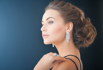 woman with diamond earrings