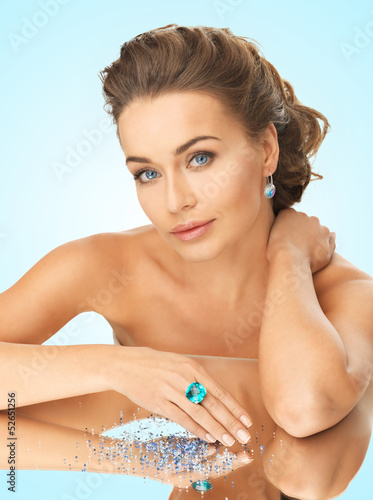 woman with cocktail ring and stones