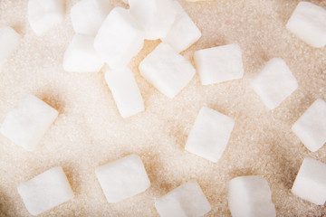 White sugar cubes and crystal sugar
