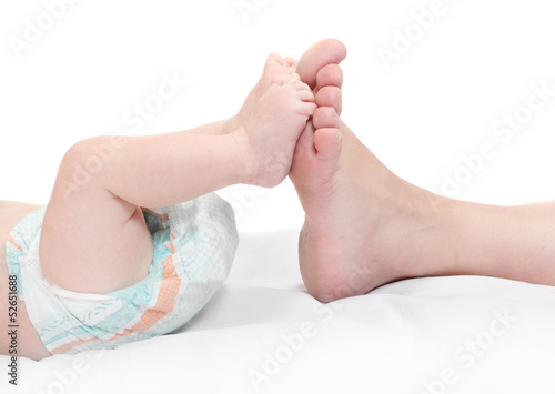 Funny picture of mothers and baby feet.