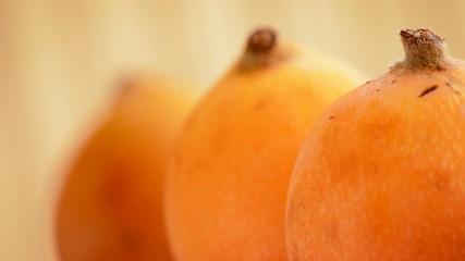 Loquat fruit gyrating, close up