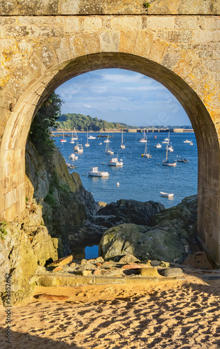 A view of the Solidor Bay via an arch of Solidor Tour complex