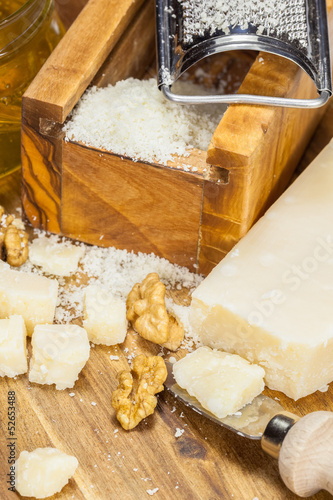 Parmesan cheese . Grated Parmesan cheese